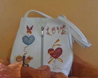 Hand-painted leather bag to be used as a shoulder strap or as a backpack.