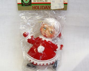 Vintage Flocked Novelty Christmas Ornament Mrs Claus skating 1960s new old stock NOS