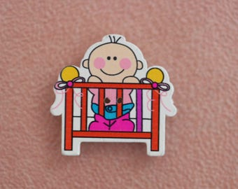 wood baby bed orange button