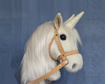 Child's Hobby horse unicorn (stick horse). Top quality plush fur fabric with hardwood pole, wheels and leather bridle with bell.  Ages 1-4