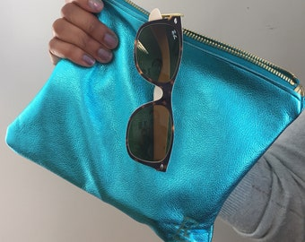 Metallic turquoise clutch or accesory bag