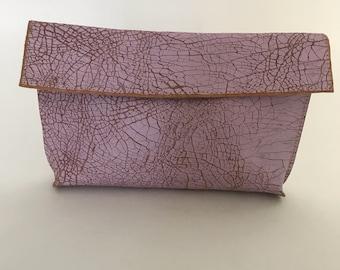Distressed pink clutch