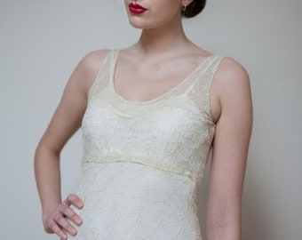 Gorgeous little whisper of a 30's vintage embroidered lace wedding dress,  in a warm cream shade. With an ivory vintage slip.