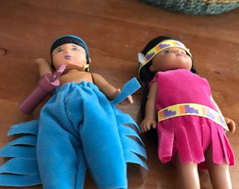 Vintage widen pair of boy and girl Indian dolls.