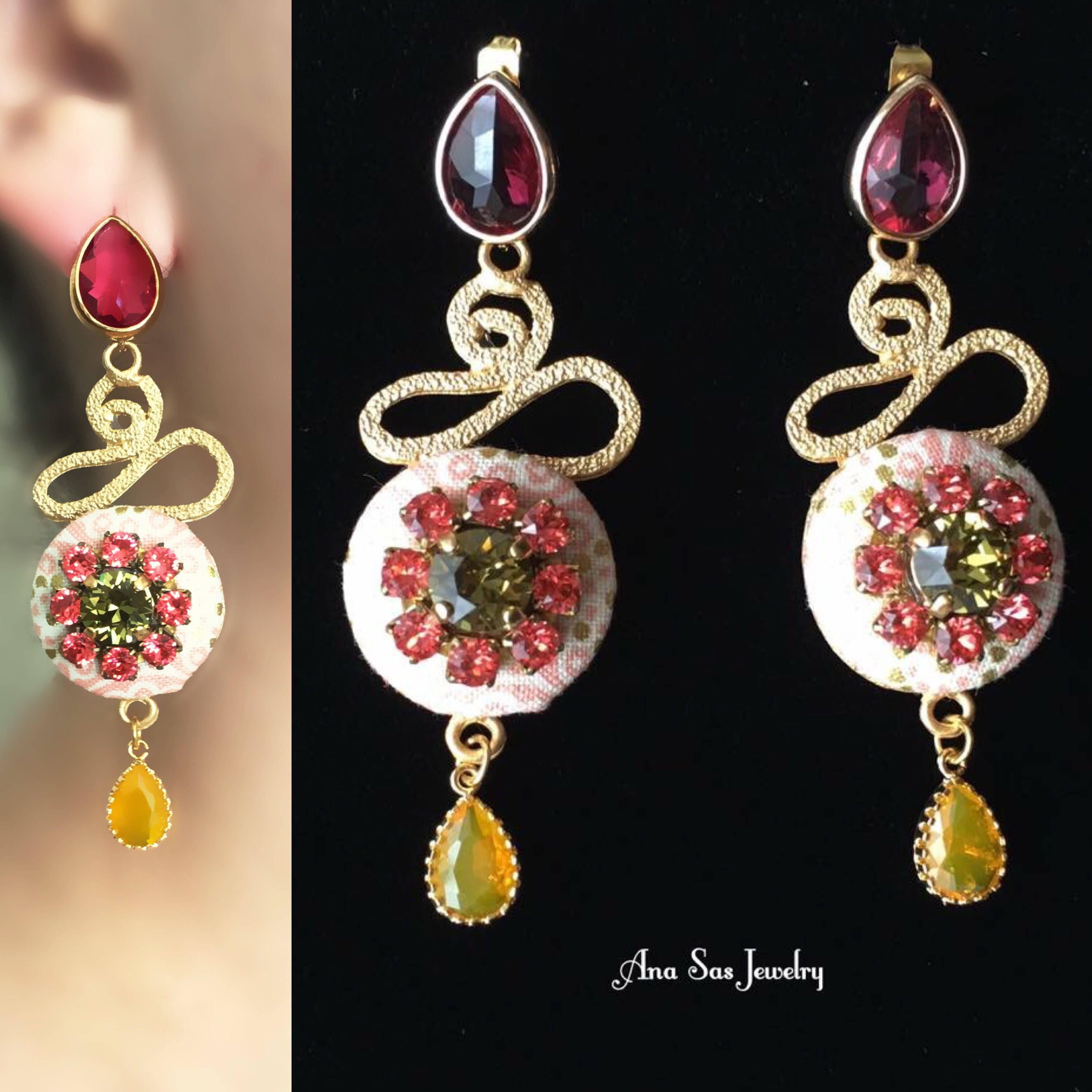 Statement gold and red rhinestone chandelier earrings arubaitofo Choice Image