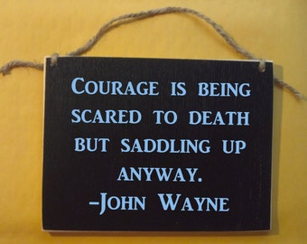 "Courage is being scared to death but saddling up anyway John Wayne saying. Funny Wood Sign Small 5x7"" gift"