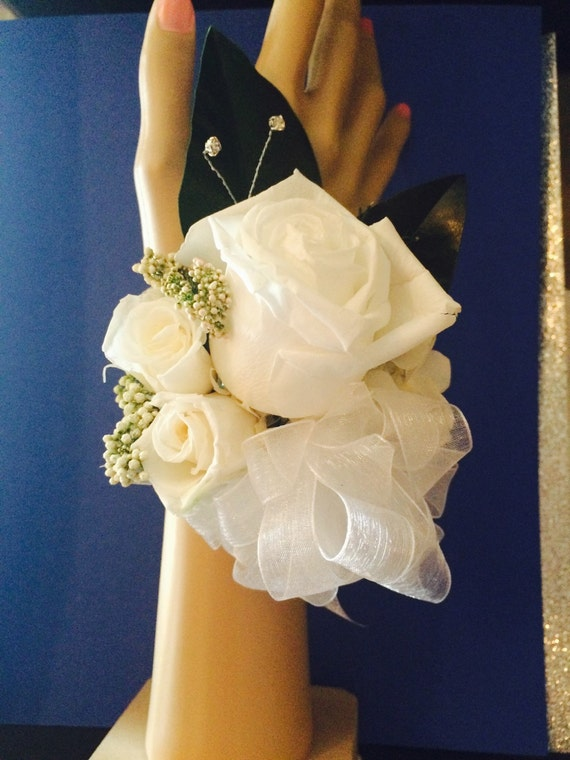 Preserved rose corsage. Roses are soft to the touch but preserved for a forever keepsake.
