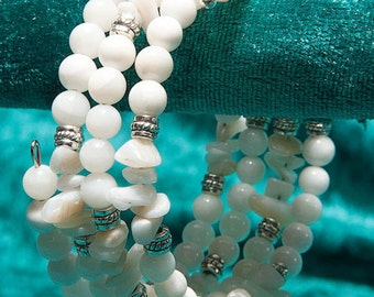 Mother of Pearl semi-precious gemstone 4-strand memory wire bracelet with Tibetan-style beads