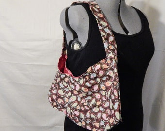 Brightly Colored, brown and pink paisley print purse, with hot pink lining.