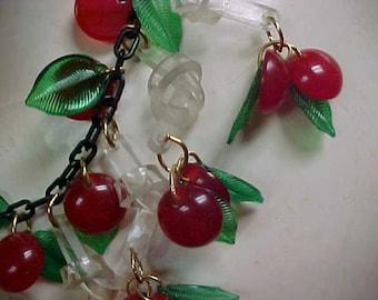 Jan Carlin Bakelite Cherry Necklace Jan Carlin Original design clear Lucite dangling Knots with red bakelite Cherries