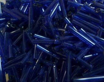 15mm transparend dark blue glass bugle beads 20gr