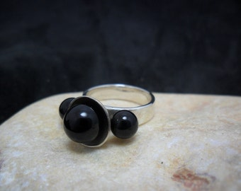 Adorned with 3 black onyx sterling silver ring