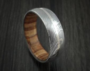 Damascus steel and palladium band custom made with apple wood sleeve