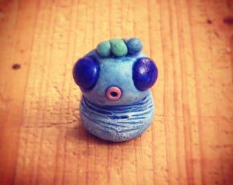 Blue Monster mini sculpture and his crest