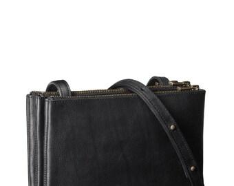 Trio shoulder bag 'Ella' in black vegetable tanned leather with brass colored hardware