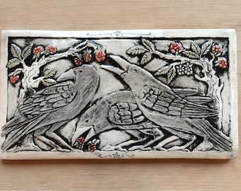 Handmade ceramic tile for wall hanging or installation with three crows