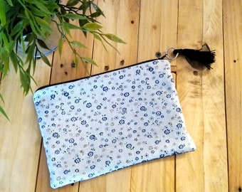 White and blue flowers and polka dots pouch