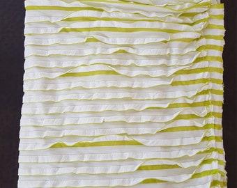 Green and white ruffle fabric