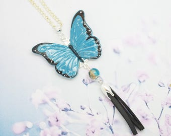blue butterfly in polymer clay necklace