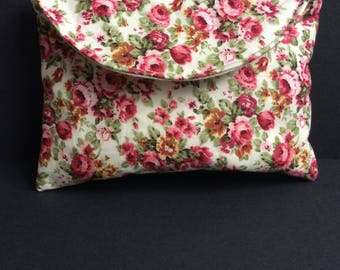 Small pink and green cosmetic/make-up bag or purse in vintage floral design