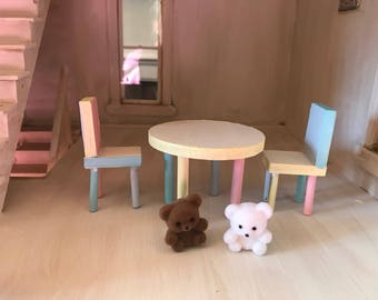 Charming dollhouse play table and chairs