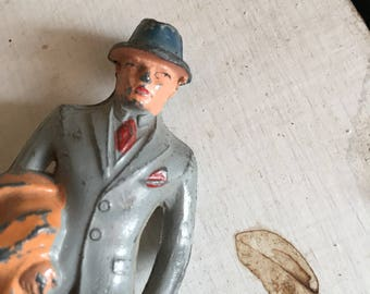 The Mr.  cast metal figure. Man in a suit