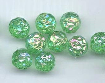Twelve vintage West German glass beads - 11.5 mm round transparent rich peridot green dimpled beads with an AB flash