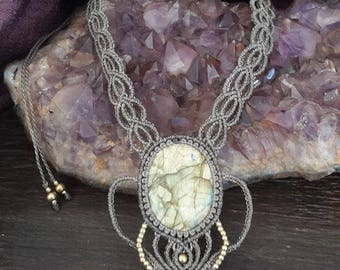 Macrame necklace with a labradorite cabochon. Fairy beige necklace. Intertwined pattern.