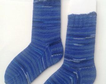 Blue striped socks, self striping pattern. Handknit socks.