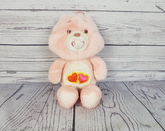 Vintage 1983 Love-a-lot Care Bear plush toy pink with 2 hearts very cute and soft Carebear