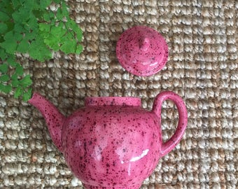 Pink speckled pottery teapot