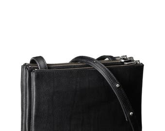 Trio shoulder bag 'Ella' in black vegetable tanned leather with silver colored hardware