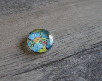 1 cabochon clear 14mm turquoise flower on yellow background