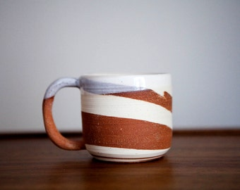 handmade white and red marbled clay coffee mug