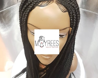 Tribal handbraided cornrow wig in colour 1. Lenght 26 inches