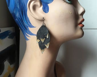 Black leather and painted metallic statement earrings