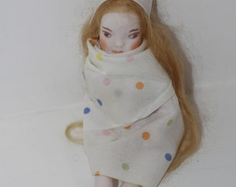 little porcelain art doll