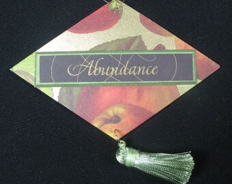 Abundance, a hand-crafted ornament with archival materials; made of approximately 70% recycled material