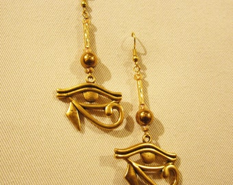 "Egyptian Eye of Horus gold tone earrings. 3"" or 7cm long x 1.25"" or 3cm"
