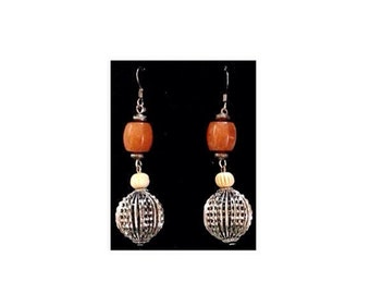 Silver, carnelian orange earrings are southwestern cowgirl chic.