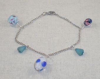 Bra023 - Bracelet à breloques perles bleues