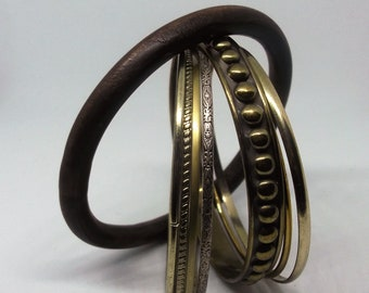8 piece set of vintage bangles gold tone and wood.