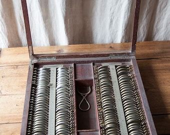 Antique old french wooden and glass box of opticians lenses for sight checking