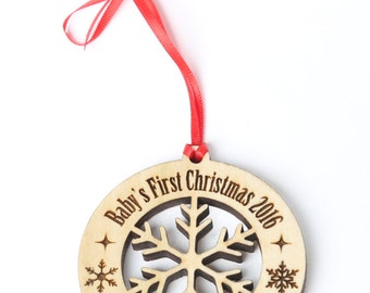 Personalized Baby's First Christmas Ornament - Solid wood engraved ornament with silhouette of a snowflake cut out. Baby gift, baby ornament