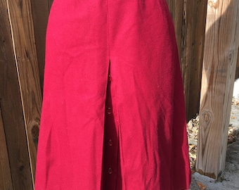 Vintage 1960s Summit of Boston 100% pure wool A-line skirt. Inverted pleat at front w/ buttons underneath.
