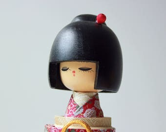 "Vintage wood kokeshi doll with silk robe, 11"" tall"