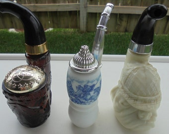 3-Avon collectible pipe shape fragrance bottles each are full
