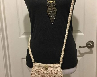 Pattern of a Charming and versatile crochet purse. Non refund.