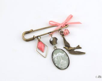 Brooch coral, gray and brass with bird #1022