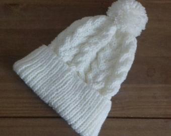 High quality hand knitted pom pom hat. Average size